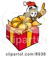 Clipart Picture Of A Wooden Cross Mascot Cartoon Character Standing By A Christmas Present