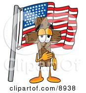 Clipart Picture Of A Wooden Cross Mascot Cartoon Character Pledging Allegiance To An American Flag