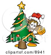 Clipart Picture Of A Wooden Cross Mascot Cartoon Character Waving And Standing By A Decorated Christmas Tree