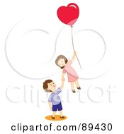 Boy And Girl Floating Away With A Heart Balloon