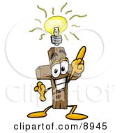 Clipart Picture Of A Wooden Cross Mascot Cartoon Character With A Bright Idea