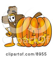 Clipart Picture Of A Wooden Cross Mascot Cartoon Character With A Carved Halloween Pumpkin