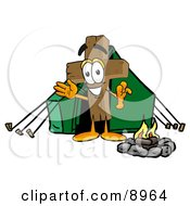 Wooden Cross Mascot Cartoon Character Camping With A Tent And Fire