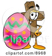 Clipart Picture Of A Wooden Cross Mascot Cartoon Character Standing Beside An Easter Egg