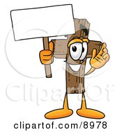 Clipart Picture Of A Wooden Cross Mascot Cartoon Character Holding A Blank Sign by Toons4Biz