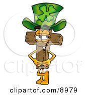 Wooden Cross Mascot Cartoon Character Wearing A Saint Patricks Day Hat With A Clover On It