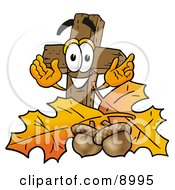 Clipart Picture Of A Wooden Cross Mascot Cartoon Character With Autumn Leaves And Acorns In The Fall