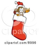 Wooden Cross Mascot Cartoon Character Wearing A Santa Hat Inside A Red Christmas Stocking