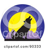 Silhouetted Howling Wolf In Front Of A Full Moon And Mountains