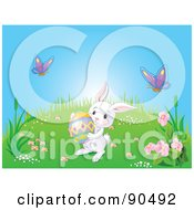 Royalty Free RF Clipart Illustration Of A Cute White Bunny Carrying An Easter Egg On A Spring Hill