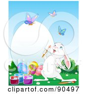 Cute White Bunny Watching Butterflies And Painting A Large Easter Egg