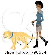 Pretty Indian Woman Walking Her Golden Retriever Dog On A Leash