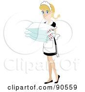Caucasian Maid Carrying Pillows