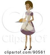 Hispanic Woman Carrying A Turkey On A Tray