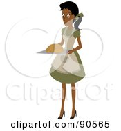 Indian Or African Woman Carrying A Turkey On A Tray