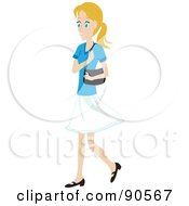 Caucasian Woman Walking With A Purse On Her Shoulder