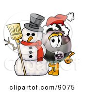 Clipart Picture Of An Eight Ball Mascot Cartoon Character With A Snowman On Christmas by Toons4Biz
