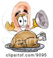 Clipart Picture Of An Ear Mascot Cartoon Character Serving A Thanksgiving Turkey On A Platter