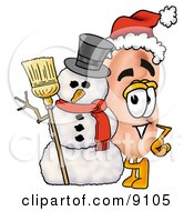 Clipart Picture Of An Ear Mascot Cartoon Character With A Snowman On Christmas