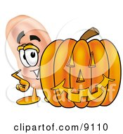 Ear Mascot Cartoon Character With A Carved Halloween Pumpkin