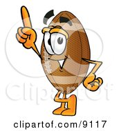 Clipart Picture Of A Football Mascot Cartoon Character Pointing Upwards by Toons4Biz
