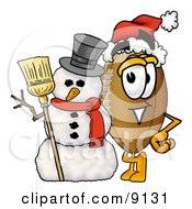 Clipart Picture Of A Football Mascot Cartoon Character With A Snowman On Christmas by Toons4Biz