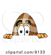 Clipart Picture Of A Football Mascot Cartoon Character Peeking Over A Surface by Toons4Biz