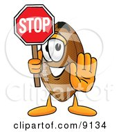 Clipart Picture Of A Football Mascot Cartoon Character Holding A Stop Sign by Toons4Biz