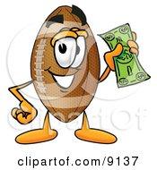Football Mascot Cartoon Character Holding A Dollar Bill