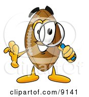Clipart Picture Of A Football Mascot Cartoon Character Looking Through A Magnifying Glass by Toons4Biz