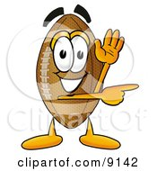 Clipart Picture Of A Football Mascot Cartoon Character Waving And Pointing by Toons4Biz