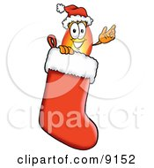 Flame Mascot Cartoon Character Wearing A Santa Hat Inside A Red Christmas Stocking