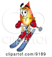 Clipart Picture Of A Flame Mascot Cartoon Character Skiing Downhill by Toons4Biz