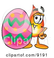 Clipart Picture Of A Flame Mascot Cartoon Character Standing Beside An Easter Egg