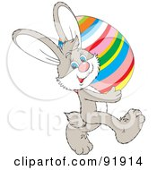 Royalty Free RF Clipart Illustration Of A Beige Easter Bunny Carrying A Colorful Striped Egg