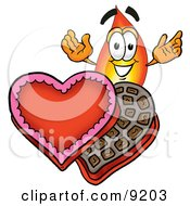 Flame Mascot Cartoon Character With An Open Box Of Valentines Day Chocolate Candies