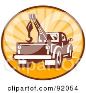Royalty Free RF Clipart Illustration Of A Retro Styled Logo Of A Tow Truck In A Sunny Circle by patrimonio