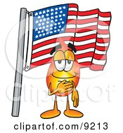 Clipart Picture Of A Flame Mascot Cartoon Character Pledging Allegiance To An American Flag by Toons4Biz