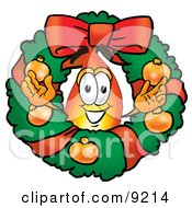 Clipart Picture Of A Flame Mascot Cartoon Character In The Center Of A Christmas Wreath by Toons4Biz