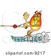Clipart Picture Of A Flame Mascot Cartoon Character Waving While Water Skiing by Toons4Biz