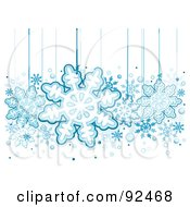 Royalty Free RF Clipart Illustration Of Blue Snowflakes Hanging From Strings by BNP Design Studio