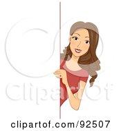 Brunette Woman Looking Around A Blank Board by BNP Design Studio