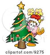 Vase Of Flowers Mascot Cartoon Character Waving And Standing By A Decorated Christmas Tree