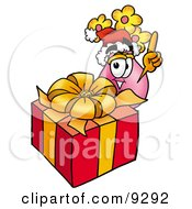 Vase Of Flowers Mascot Cartoon Character Standing By A Christmas Present by Toons4Biz