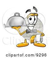 Golf Ball Mascot Cartoon Character Dressed As A Waiter And Holding A Serving Platter