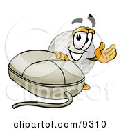 Clipart Picture Of A Golf Ball Mascot Cartoon Character With A Computer Mouse