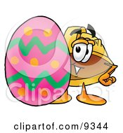 Clipart Picture Of A Hard Hat Mascot Cartoon Character Standing Beside An Easter Egg by Toons4Biz