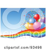 Confetti And Party Balloons On A Rainbow Over A Blue Background