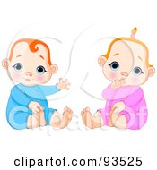 Digital Collage Of A Baby Boy Waving And Baby Girl Sucking Her Thumb