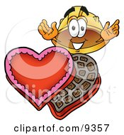 Hard Hat Mascot Cartoon Character With An Open Box Of Valentines Day Chocolate Candies by Toons4Biz